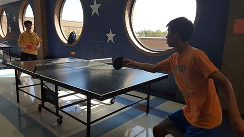 2 club members playing ping pong