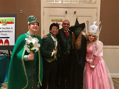 Wizard of Oz cast members pose with Dr. Dupre, Superintendent of FBISD Schools, at the FBISD Educational Foundation Gala